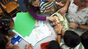 1447799842_us_navy_081123-n-7862m-001_students_from_the_bahrain_school_share_an_interactive_reading_experience_with_u.s._naval_support_activity_bahrain_command_master_chief_randy_shoe_during